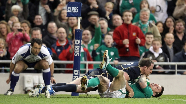Ireland's Tommy Bowe tackled by Graeme Morrison of Scotland as his try is not given