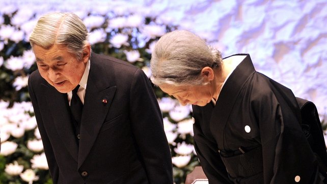 Japanese Emperor Akihito and Empress Michiko bow their heads for the victims of the 11 March 2011 earthquake in Tokyo