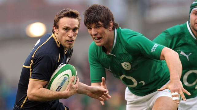 Donncha O'Callaghan chases down Scotland's Mike Blair