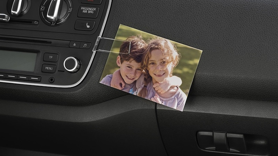 The optional photo clip on the dashboard is a touch of class