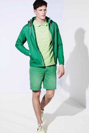 Forest green hooded jacket €126 Farah, Citrus polo shirt €66 Lyle & Scott, Green slim fit shorts €100 Polo Ralph Lauren, Fluorescent running shoes Nike