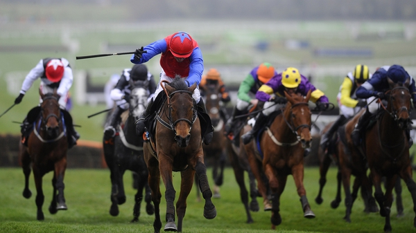 Quevega (red & blue on left) surges clear with Ruby Walsh in the saddle