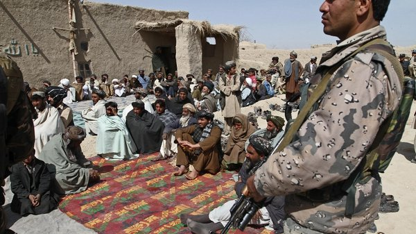 Afghan men at a memorial service for the 16 slain villagers
