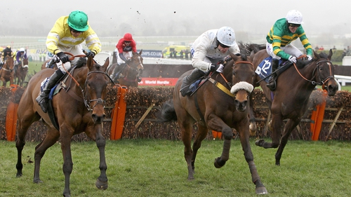 Cape Tribulation ridden by Denis O'Regan (centre) beats Catch Me ridden by Tony McCoy (right) and Cantlow ridden by Dominic Elsworth (left) in the Pertemps Final