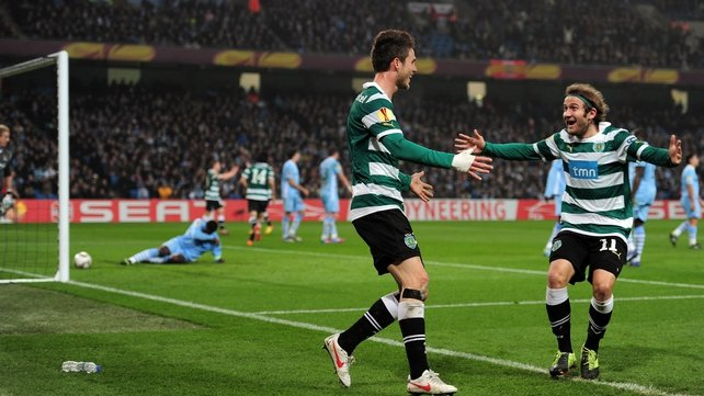 Sporting Lisbon's Diego Capel (right) celebrates with goalscorer Ricky van Wolfswinkel (left)