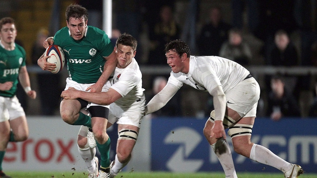 Ireland's JJ Hanrahan is tackled by England's Will Addison