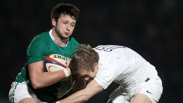 Ireland's Conor Finn is tackled by England's Charlie Walker