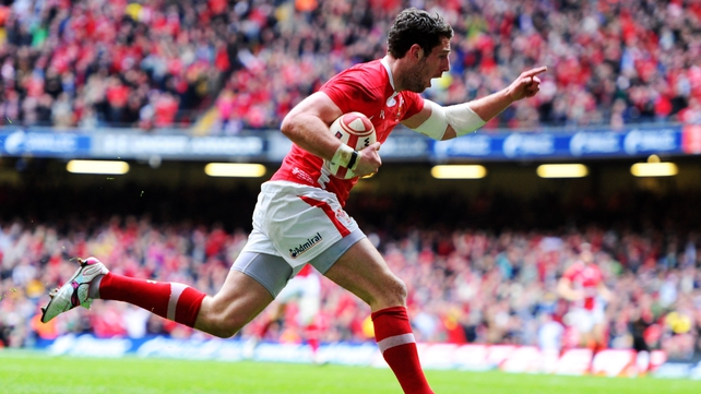Alex Cuthbert runs in the only try of the Grand Slam decider in Cardiff