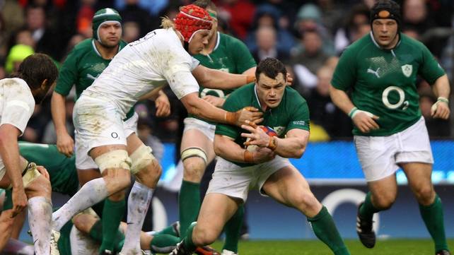 Mouritz Botha of England tackles Cian Healy of Ireland
