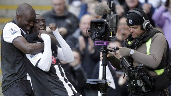 Newcastle's goalscorer Papiss Demba Cisse (c) and Demba Ba celebrate the only goal of the game