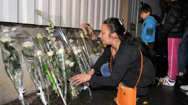 People lay flowers in front of the 'Ozar Hatorah' Jewish school in Toulouse