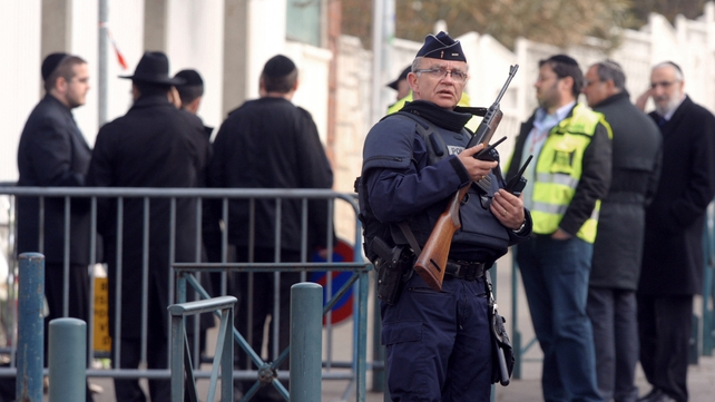Policemen stand guard in front of the 'Ozar Hatorah' Jewish school in Toulouse