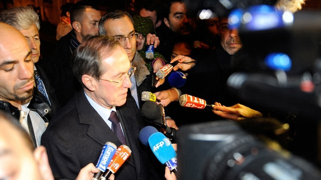 French Interior Minister Claude Gueant speaks to reporters at the scene