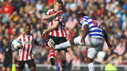 Republic of Ireland and Sunderland winger James McClean challenges Nedum Onuoha of QPR