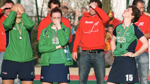 Ireland players are dejected as they receive medals for finishing second in the 'Road To London' tournament