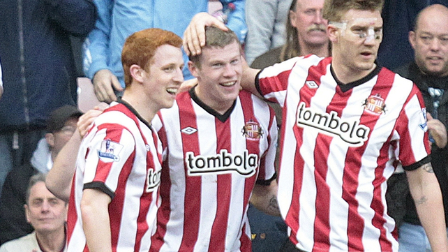 James McClean (C) is congratulated by team mates after scroring Sunderland's second goal against QPR