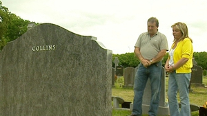 Steve and Carmel Collins pictured at their son Roy's grave
