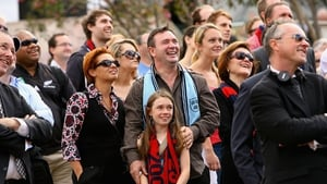Members of the crowd enjoy a lighter moment during the service