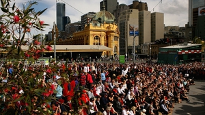 Crowds follow proceedings attentively at Federation Square