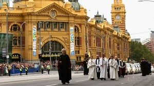 The funeral procession proceeds on Flinders Street
