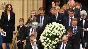 The coffin of Jim Stynes is carried out of the catherdal