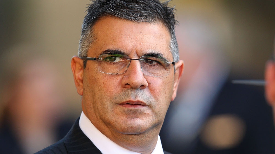 Chief Executive Officer of the Australian Football League Andrew Demetriou arrives to attend the funeral
