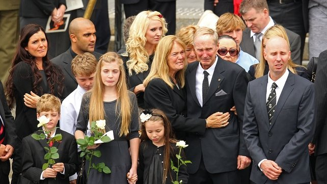 Jim Stynes' coffin is carried from St Paul's Cathedral in Melbourne