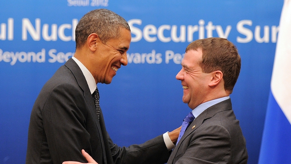 US President Barack Obama and Russian President Dmitry Medvedev share a smile after their bilateral meeting in Seoul