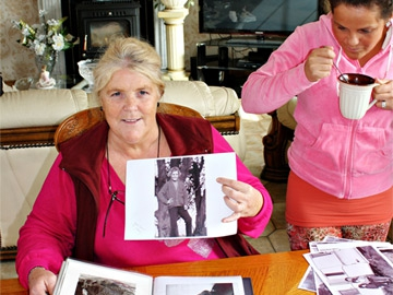 Josie O'Leary with a picture of herself taken in 1971