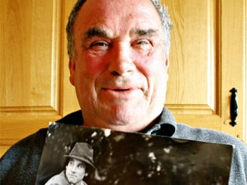 Patrick Maughan with a photograph of himself taken in 1971