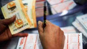 A woman fills out a Mega Millions lottery ticket form in California