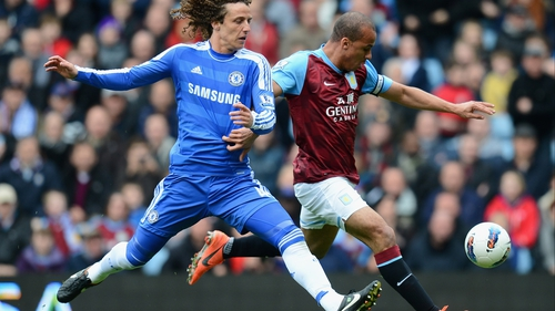 Gabriel Agbonlahor gets a shot away despite the attentions of David Luiz