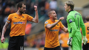Wayne Hennessey (R) of Wolves squares up to his captain Roger Johnson (L)