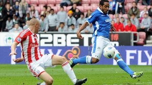 Wigan's Jean Beausejour (R) missed an open goal during the first half