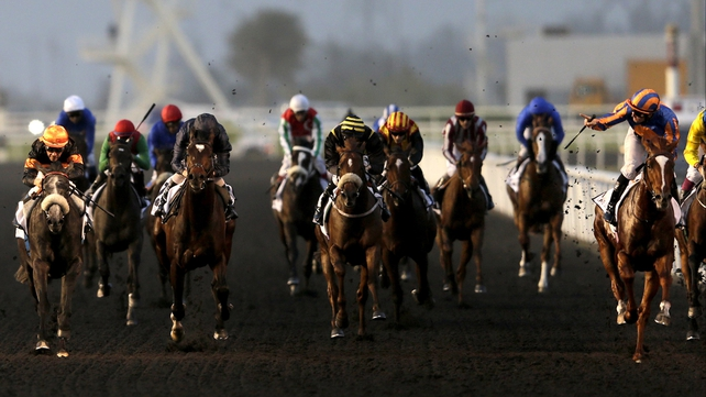 Colm O'Donoghue (r) celebrates after driving Daddy Long Legs to victory in the UAE Derby