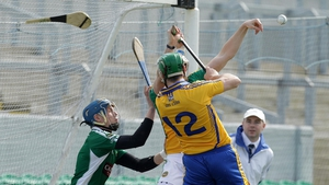 Fergal Lynch of Clare, who was later sent off, breaks his hurley as he goes for goal