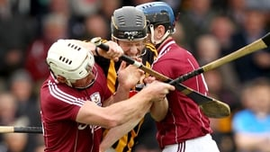 Galway's David Burke and Brian Flaherty make life difficult for Michael Rice of Kilkenny, but the Cats ran out 25-point winners