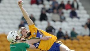 Aaron Cunningham of Clare beats David Kenny to the sliotar