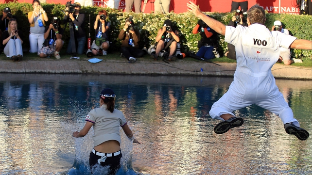 Sun Young Yoo and caddie Adam Woodward cool off in the Poppy's Pond after Yoo's dramatic major victory
