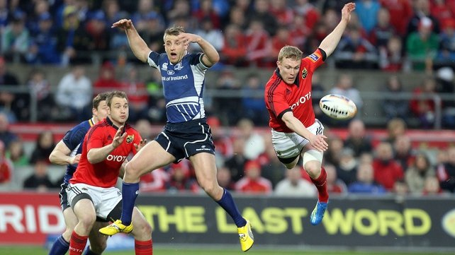 Luke Fitzgerald and Keith Earls compete for a ball during a Munster v Leinster derby clash - this season's meeting is live on RTÉ Two, RTÉ Two HD and Online on 5 October