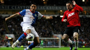 Bradley Orr and Wayne Rooney in action during tonight's fixture at Ewood Park