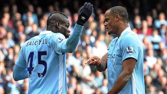 Mario Balotelli and Manchester City captain Vincent Kompany during the 3-3 draw with Sunderland