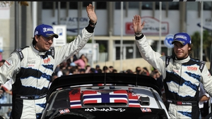 Mads Osteberg (R) and his Swedish co-driver Jonas Anderson