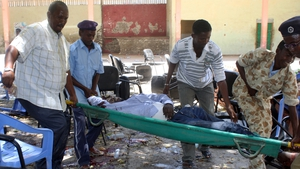 A victim of a suicide attack is carried on a stretcher