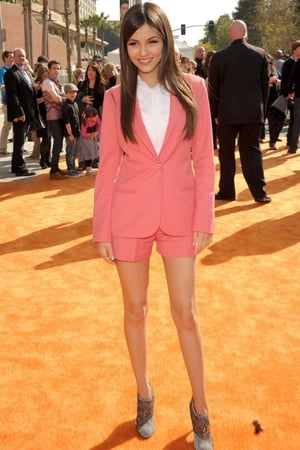 Proof that this girl is going to be huge. At the Kids Choice Awards it's an occasion young starlets can really accentuate their girlyness in frills, bare midriffs and dresses (yes, you Selena Gomez). Whereas Victoria Justice has gone the complete opposite