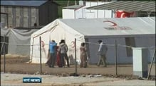 Thousands of Syrians flee to Turkey