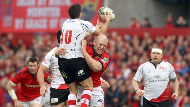 Munster captain Paul O'Connell tackles Ulster out-half Ian Humphreys