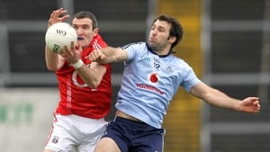 Graham Canty of Cork and Bryan Cullen of Dublin battle for possession