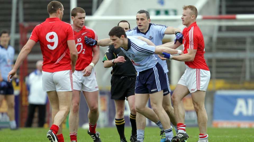 Cork's Michael Shields restrains Dublin's Diarmuid Connolly during the Allianz FL game at Páirc Ui Chaoimh. The Rebels ran out winners on a 1-12 to 0-12 scoreline