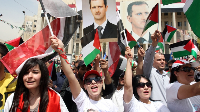Supporters of President Bashar al-Assad wave Syrian Baath Party and Syria flags at the weekend